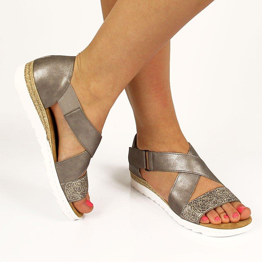 974fb42d24ca Srebrne sandały damskie na rzep Rieker 63085-91. Damskie buty na niskim  obcasie ...
